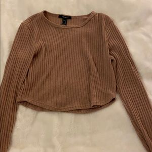 Long sleeve brown crop top.
